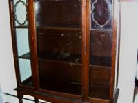This is an antique wood display cabinet with the old