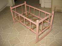 Old rocking-style doll crib in good condition. Solid,