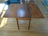 ANTIQUE DOUBLE-DROP-LEAF TABLE. Antique maple