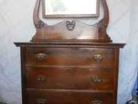 I have an old oak dresser and mirror. Good condition.