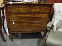 Beautiful dark wood dresser. It sits on wheels for easy