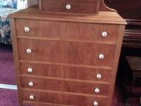 In very nice condition, original wood wheels.   Dresser
