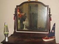 vintage/antique dresser with swivel mirror.4 draws two