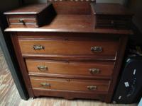For sale is an antique dresser in fairly good