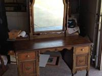 This piece is a 1930s depression period dresser/vanity.