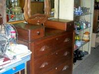 This is very nice antique dresser, it has a glove box