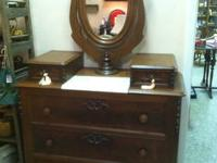 Very nice condition dresser. Mirror swivels and tilts.