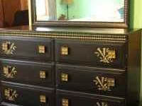 Solid wood dresser painted black with gold