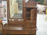 Antique dresser with mirror and drawers on top and