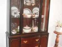 Antique 1940's solid mahogany china cabinet.