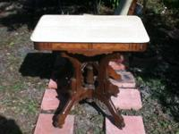 This antique Eastlake table is in great condition! It