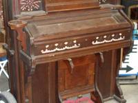 This Antique Eastlake Style Chicago Cottage Pump Organ