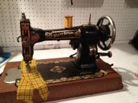 Antique Electric White Rotary Brand Sewing Machine.