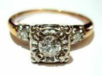 One ladies 14K (Stamped) white and yellow gold diamond