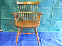 This is an antique, maple wood, Captains Chair that was