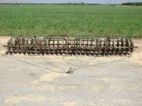 THIS IS AN OLD JOHN DEERE 4 ROW CRUST BUSTER. WHEN WE