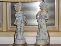 Boy and girl figurine lamps in brass setting.