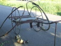 I have an antique firemans hose cart that is in need of