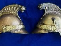 These late 19th century repousse brass French fire