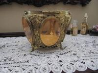 This is a stunning antique gilded jewelry box with 6