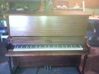Nice antique Gulbransen upright piano. According to the