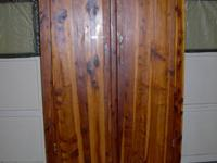 This is an Antique handmade Cedar Wardrobe. There are