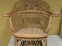 "This child's wicker rocking chair is 24"" higher, 24"""