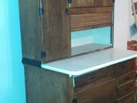 ntique hutch / cabinet. Has roll-up front, flour bin