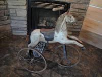 VERY OLD HORSE TRICYCLE IN EXCELLENT CONDITION. ALL