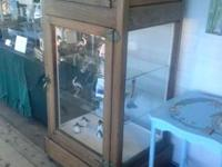 Antique ice box in oak. Brass manages, glassed sides,