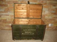 Post World War II wooden trunk with steel edging in