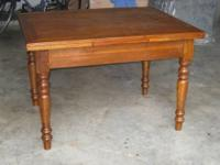 Gorgeous antique wood table with 2 pull out leaves.
