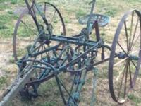 Antique John Deere cultivator- once used right here on
