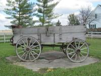 Antique John Deere field wagon circa 1880-1900.  Wheel