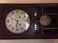 This is an antique wall chime clock by the German