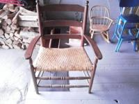 "NICE ANTIQUE WOOD CHAIR W/A CANE SEAT. SEAT 26"" WIDE AT"