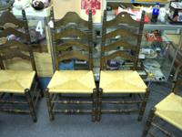 Set of six brown antique ladder back chairs with tan