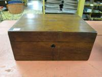 This is a nice wooden antique lap desk. It has a red