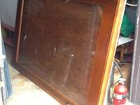 Large antique oak display case with glass. Measures 4'