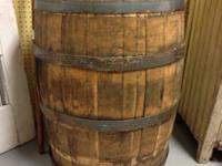 Available is a large wooden barrel with steel rings