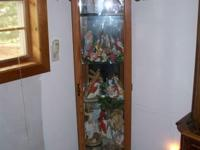 We have an OAK Antique lighted Curio Cabinet for sale!
