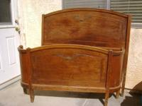 This Antique Bed is made of mahogany & embellished with