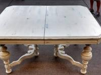 This is an antique mahogany table that has been painted