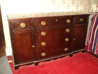 This is an actually nice buffet Sideboard. I believe to