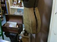 For a vintage clothing collector, an antique mannequin