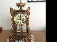 Beautiful Antique mantel clock by Astonia of NY. Works