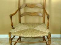 This chair is from the 1800's and was hand crafted. It