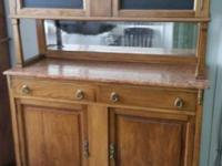 Very old hutch with marble top and glass upper doors