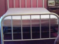 This antique metal bed is approximately 100 years old