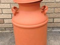 "Antique milk can  22"" tall, bottom of can is 13"" across"